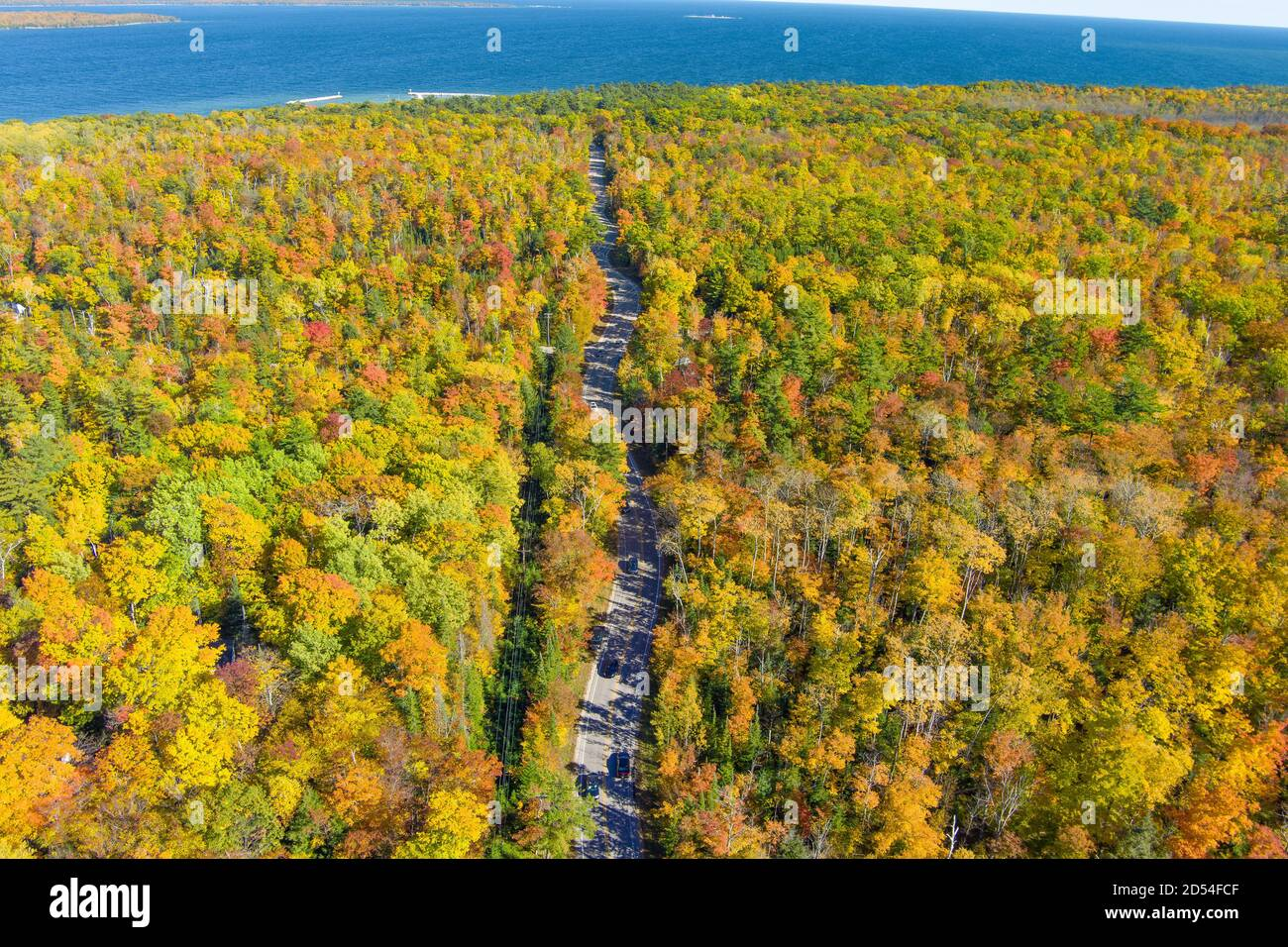 A long winding road during autumn with a drone Stock Photo