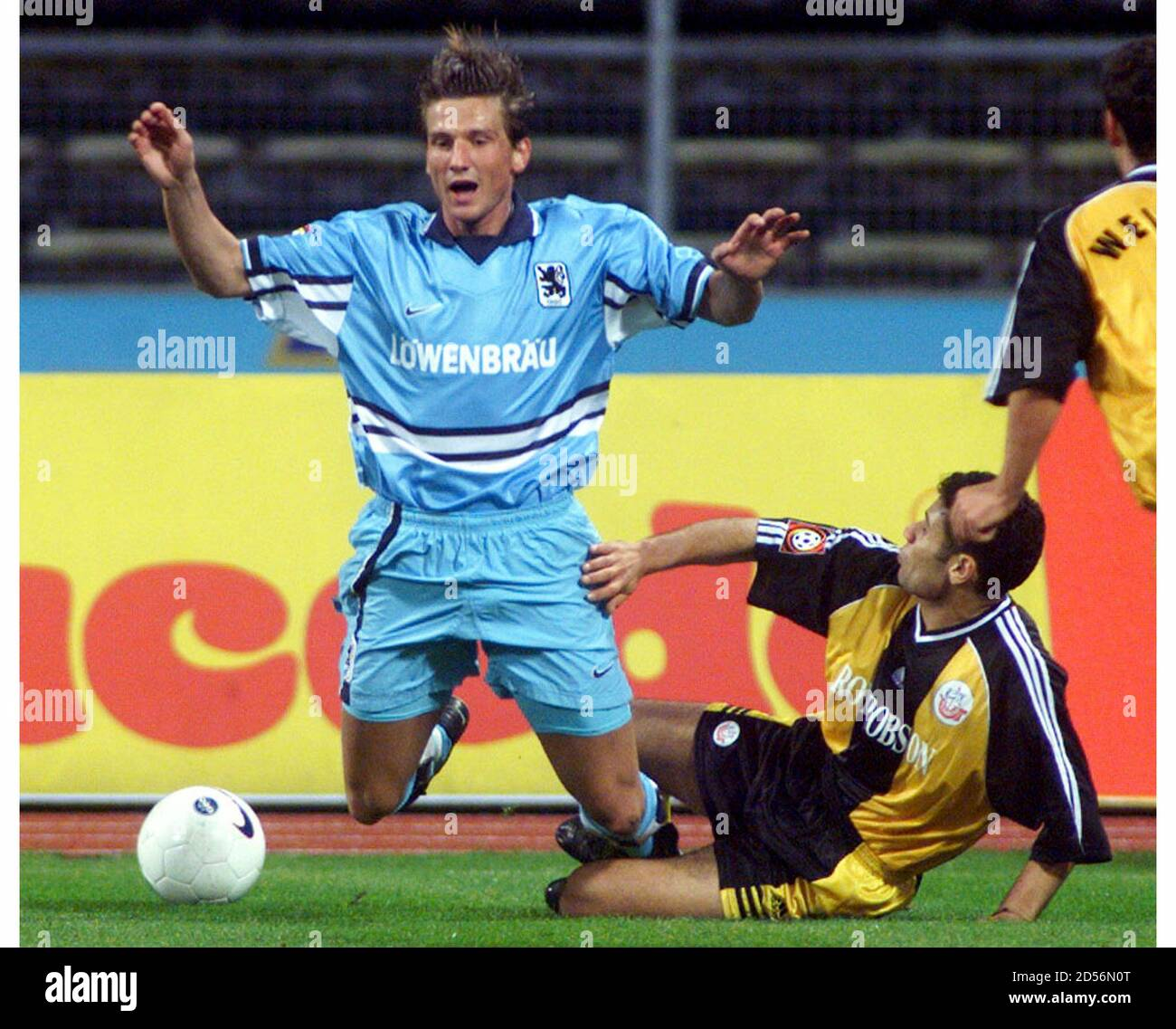 Stefan Malz Of Tsv 1860 Munich And Raduan Of Fc Hansa Rostock Fight For The Ball In Munichs Olympic Stadium Stefan Malz Of Tsv 1860 Munich L And Jasser Raduan Of Fc