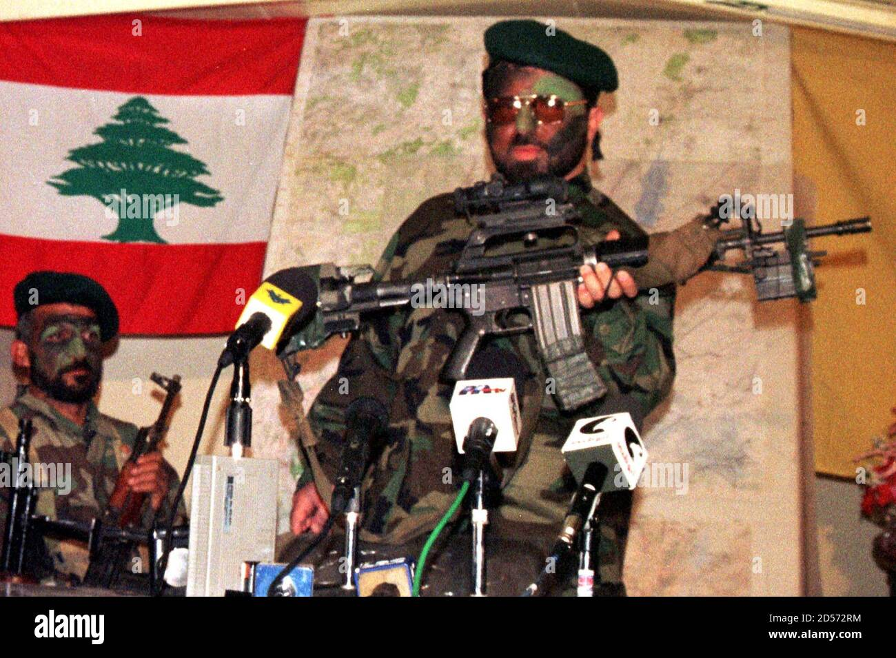 A Pro-Iranian Hizbollah geurrilla who staged the attack on the Israeli patrol February 23 shows reporters an M18 rifle bilonging to one of the dead Israeli officers, during a news conference held at a mountain cave less than five kms (miles) away from Berkit Jabour, in the Bekaa valley. The guerrillas killed three Israeli officers and wounded five other soldiers in fierce clashes overnight, a source in Israel's South Lebanon Army (SLA) proxy said on Tuesday.  JS/FMS Stock Photo