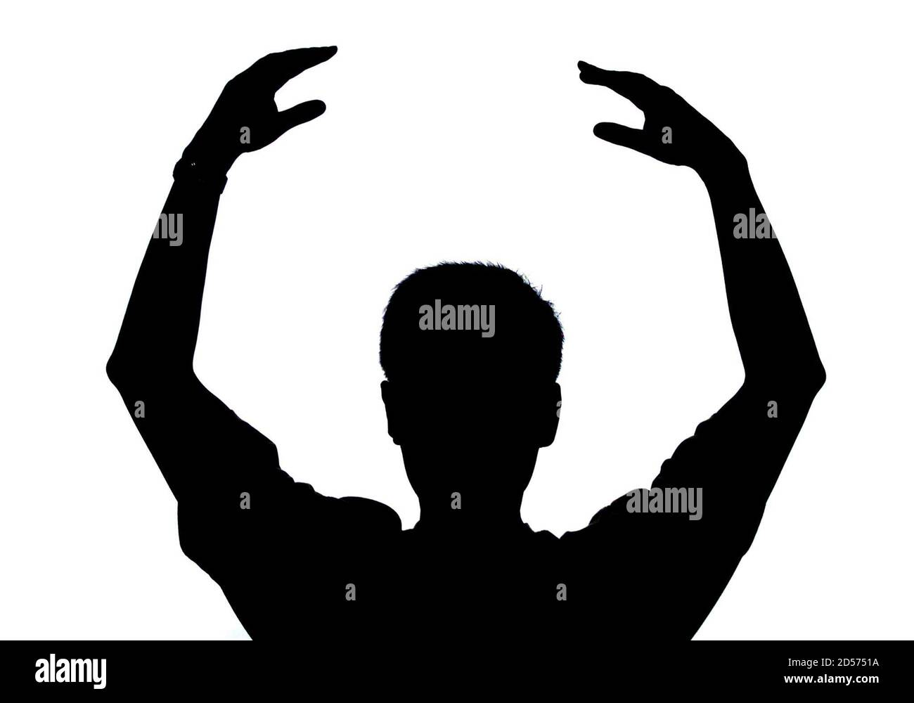 A member of the banned Falun Gong is silhouetted as he performs breathing exercises at a private place in Beijing August 8. China, waging a war of words against the spiritual movement that claims 100 million members, labelled it a very dangerous cult on Tuesday. China outlawed Falun Gong on July 22, calling it an illegal organisation that corrupted the people's minds and sabotaged stability. A large number of Falun Gong members are continuing to practise at private places despite the government ban.  ASW/CC Stock Photo