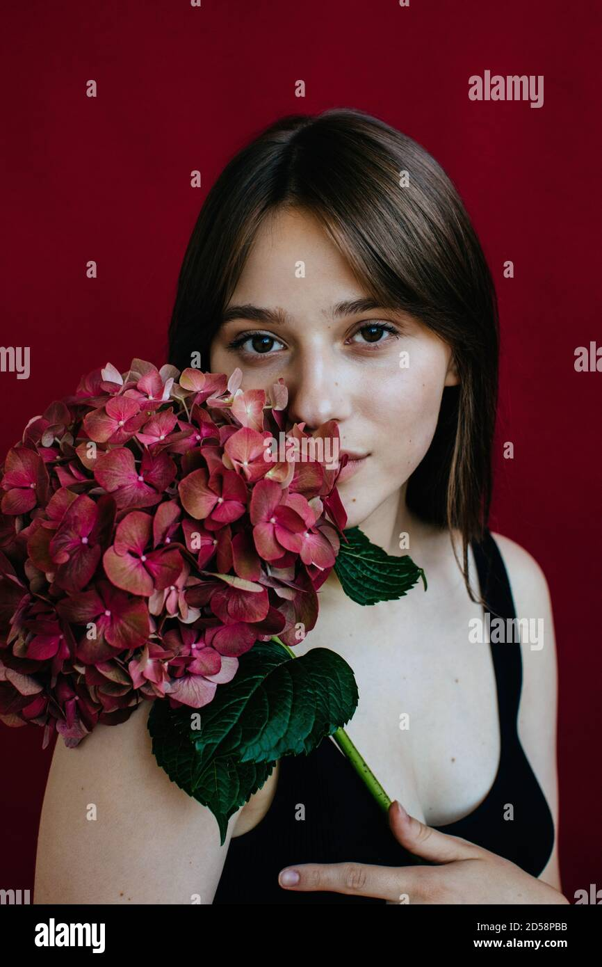 Portrait of a young woman holding a hydrangea Stock Photo