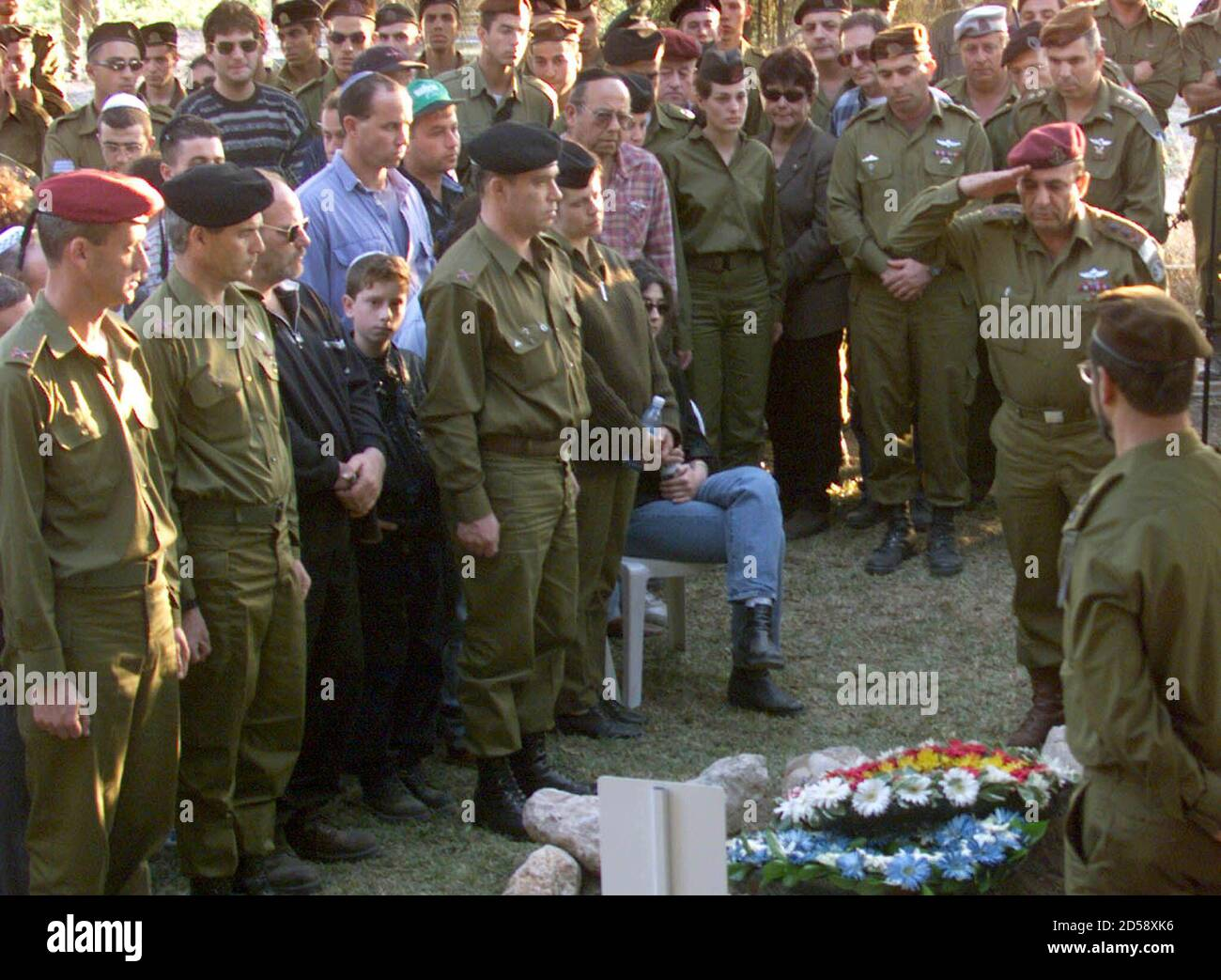 Israeli chief Shaul Mofaz salutes the fresh grave of Brigadier-General Erez Gerstein during a heroes funeral attended by thousands of mourners including senior army officers and politicians March 2. Gerstein, one of Israel's senior commander in its self-declared South Lebanon security zone, was killed alongside two soldiers and a civilian radio reporter when their convoy was attacked by pro-Iranian Hizbollah guerrillas in South Lebanon two days ago.  DPS/WS Stock Photo