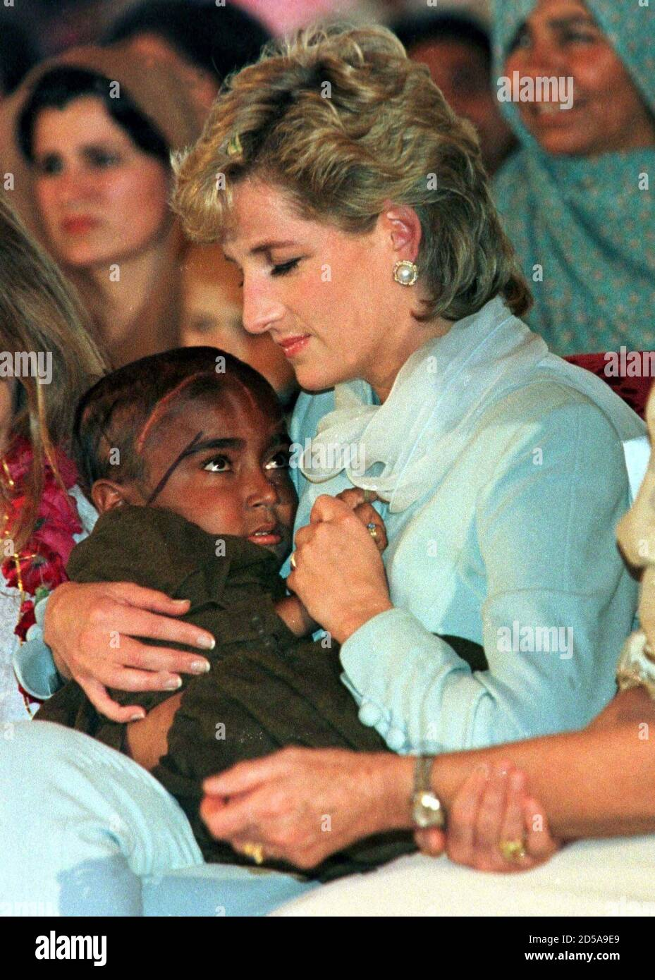 young princess diana high resolution stock photography and images alamy https www alamy com file picture 22aug96 princess diana cradles a young child with cancer during a show at the shaukut khanum memorial cancer hospital in lahore pakistan next monday august 31 marks the first anniversary of princess dianas death from injuries sustained in a car crash in paris kc image381928353 html