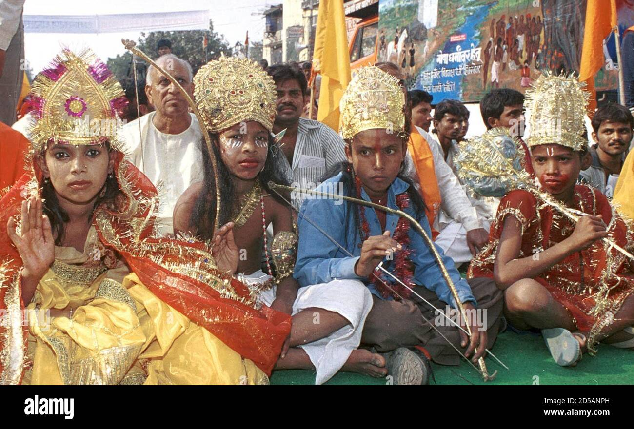 Dressed as Hindu gods, the young members of India's hardline Vishwa Hindu Parishad protest in New Delhi November 4. The group has called for an apology from the Pope for what it calls forced conversions of poor Hindus to Christianity. Pope John Paul ll will visit India from November 5-8.  KK/DL Stock Photo