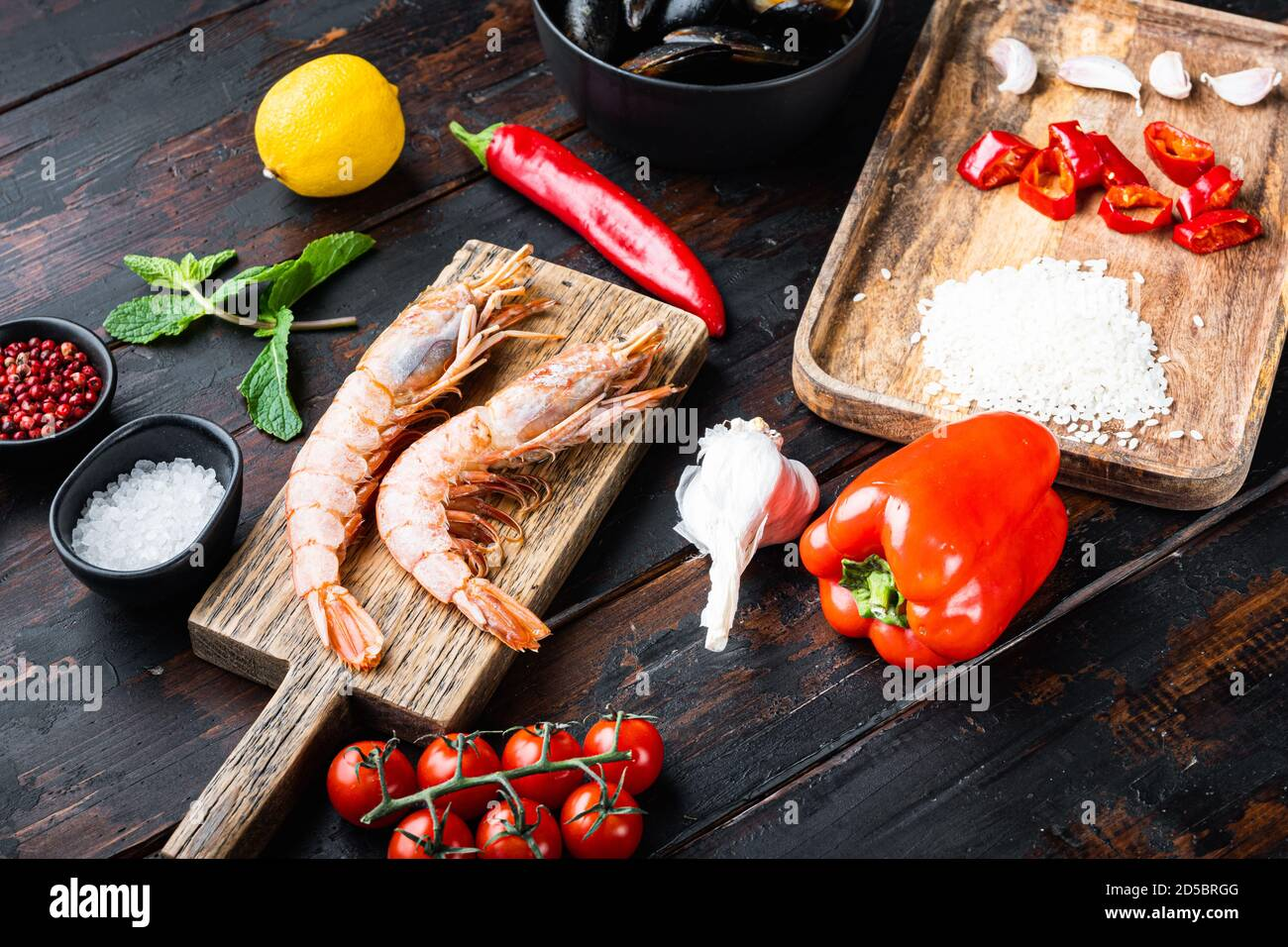 Traditional spanish seafood paella ingredients on old wooden dark table Stock Photo