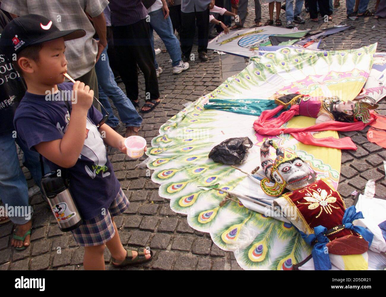 An Indonesian boy looks at traditional kites from West Javaduring an Jakarta International Kite Festival in Jakarta July 18. Jakarta is holding a two-day kite festival to celebrate the 472nd anniversary of the founding of the city.  PRI/DL Stock Photo