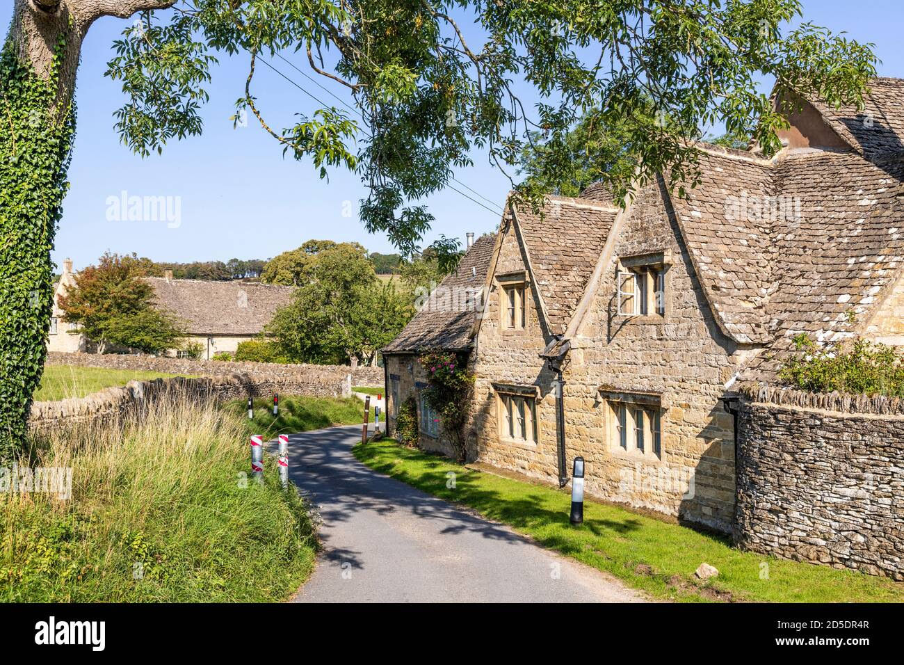 Old stone cottages at Barton near the Cotswold village of Guiting Power, Gloucestershire UK Stock Photo