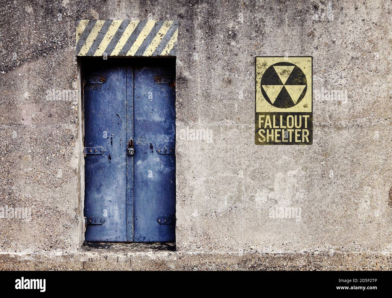 Mysterious padlocked reinforced steel door to a concrete nuclear bunker underground radiation fallout bomb shelter Stock Photo