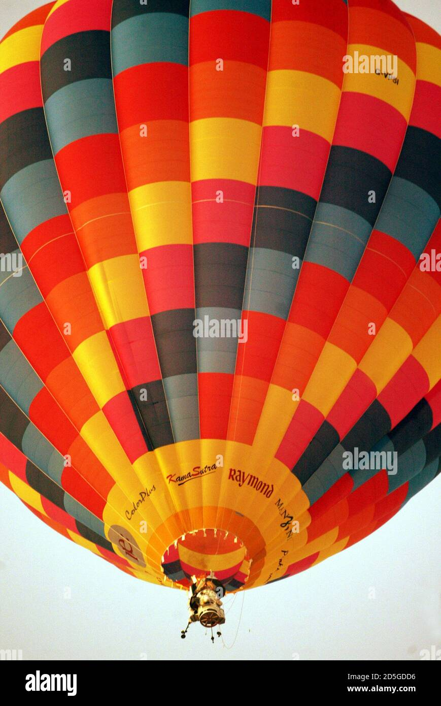"""Industrialist Vijaypat Singhania's hot air balloon takes off in Mumbai November 26, 2005. Singhania took off in his hot air balloon capsule in an effort to reach a height of 70,000 feet (above 21,336 meters) above sea level on Saturday, part of an attempt to break the existing world record set for """"High altitude in hot air balloon."""" The current record is held by Per Lindstrand, who reached a height of 64,997 feet (19,811 meters) in Plano, Texas, on June 6, 1988. REUTERS/Punit Paranjpe Stock Photo"""