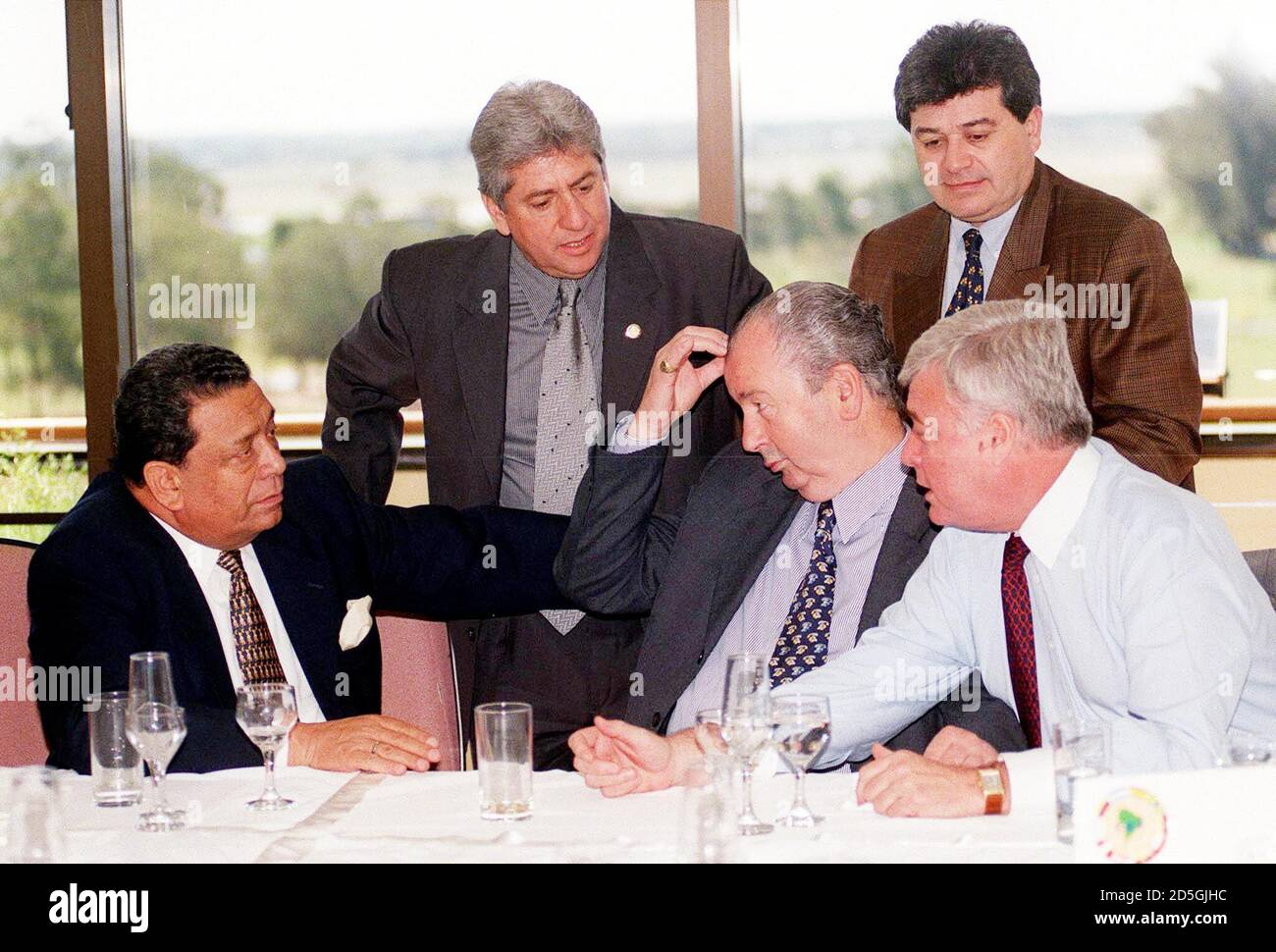 Presidents of the soccer federations (seated, L-R) from Peru, Eduardo Delfino, Argentina, Julio Grondona, and Brazil, Ricardo Teixeira, talk with (standing, L-R) Nelson Gutierrez of Uruguay and Nestor Benitez of the South American Soccer Confederation, during a break in a meeting, September 15. The coaches participated in a continent-wide meeting to decide on the calendar for the qualifying matches leading up to the World Cup to be played in Korea and Japan in 2002.  RR/BM Stock Photo