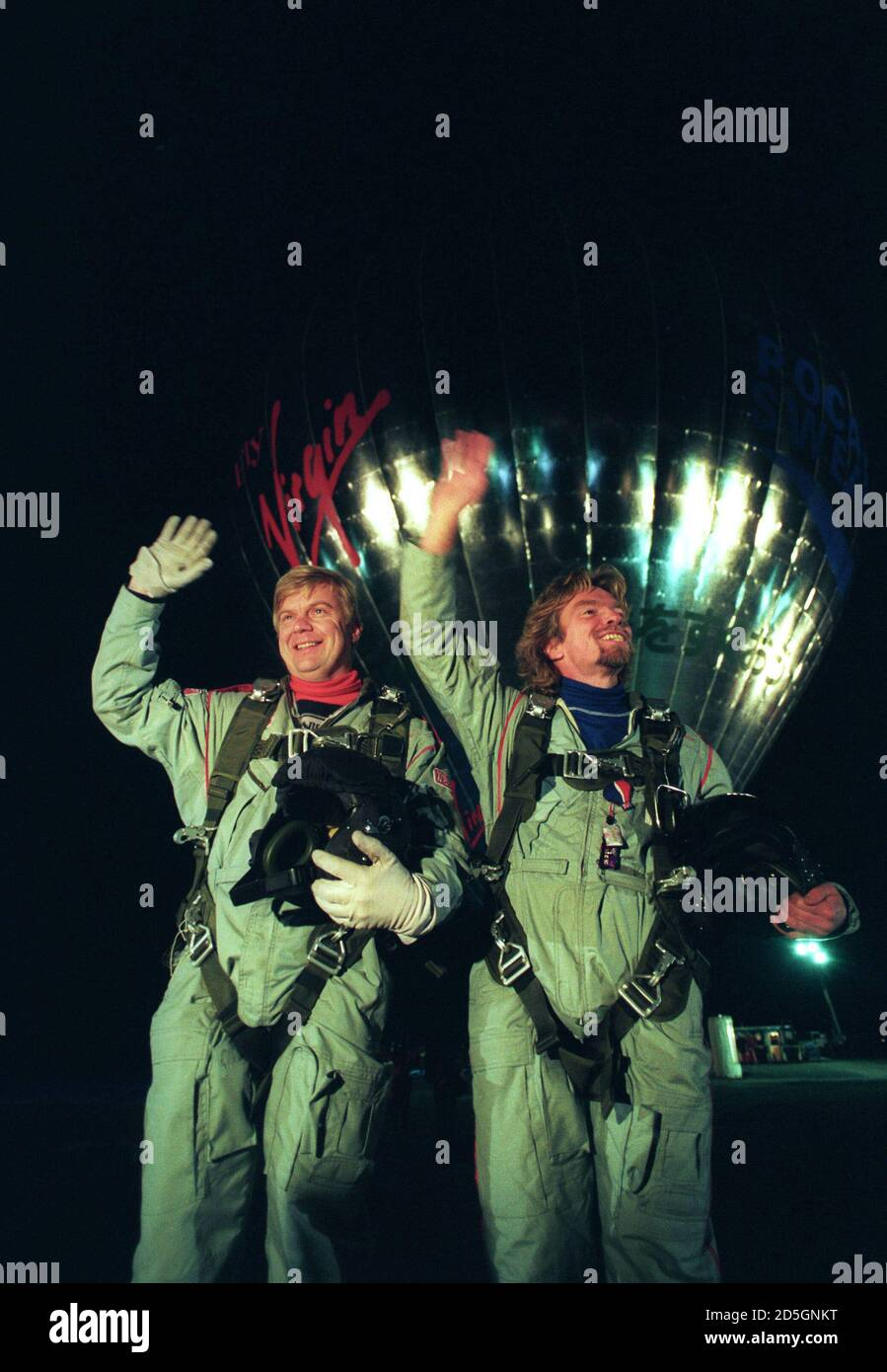 Virgin Atlantic Chairman Richard Branson (R) and co-pilot Per Lindstrand smile and wave to a cheering crowd of 10,000 just before lift-off from Miyakonojo, southern Japan early January 16, 1991 in their attempt to become the first to cross the Pacific Ocean by hot-air balloon.  Reuters/Eriko Sugita Stock Photo