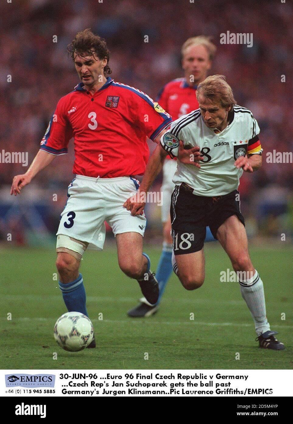 Czech Rep's Jan Suchoparek gets the ball past Germany's Jurgen Klinsmann Stock Photo