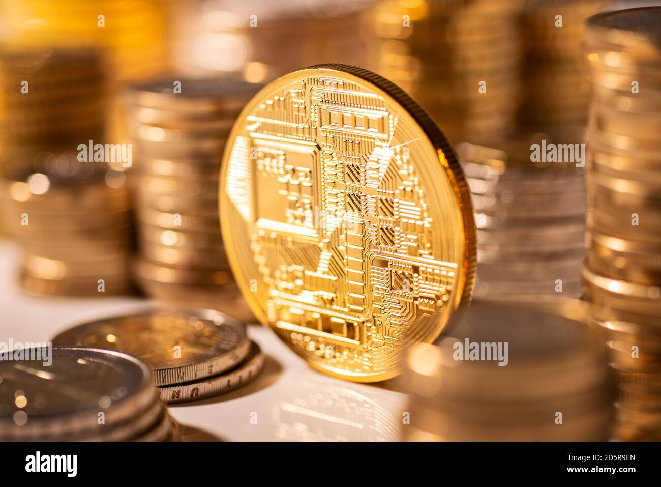 Coin with the pictogram of a circuit board as symbol for crypto currencies Stock Photo