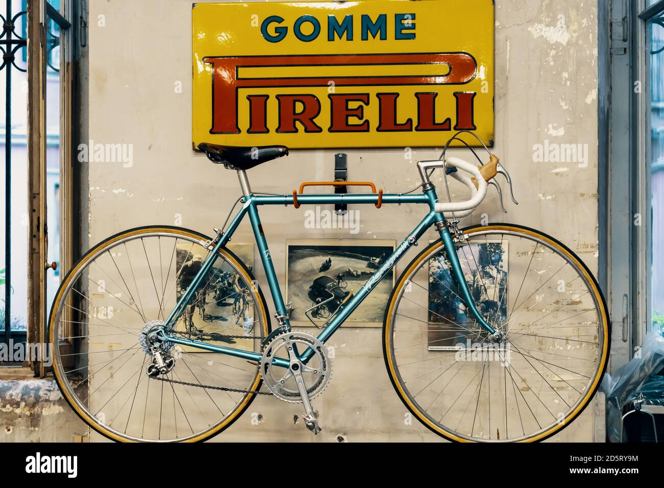 Logo Pirelli on the wall, bicycle in bicycle store. Pirelli is an Italian multinational company, focused on the consumer business. Milan, Italy - 28 Stock Photo