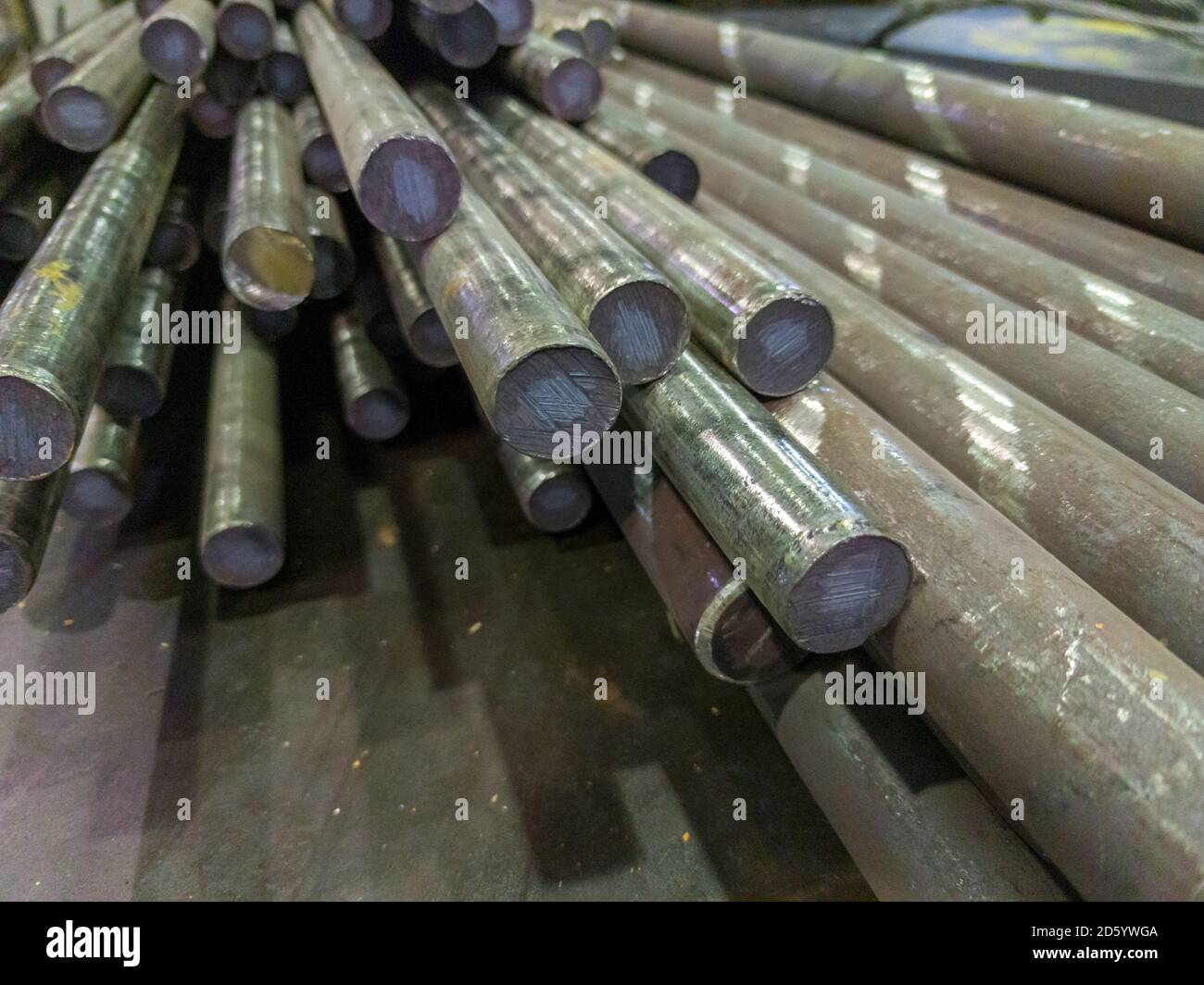 raw stainless steel rods storage - closeup with selective focus and background blur Stock Photo