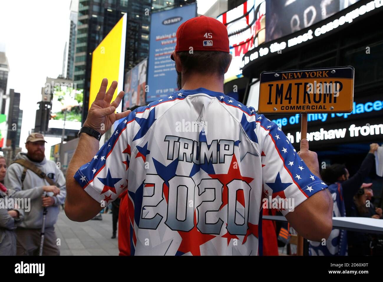 New York, United States. 13th Oct, 2020. Trump supporters march on Fifth Avenue to Times Square as contentious political and judicial topics are being debated in Washington DC. Issues concerning the health of the President and optimism of his re-election resounded among the rally participants. Credit: SOPA Images Limited/Alamy Live News Stock Photo