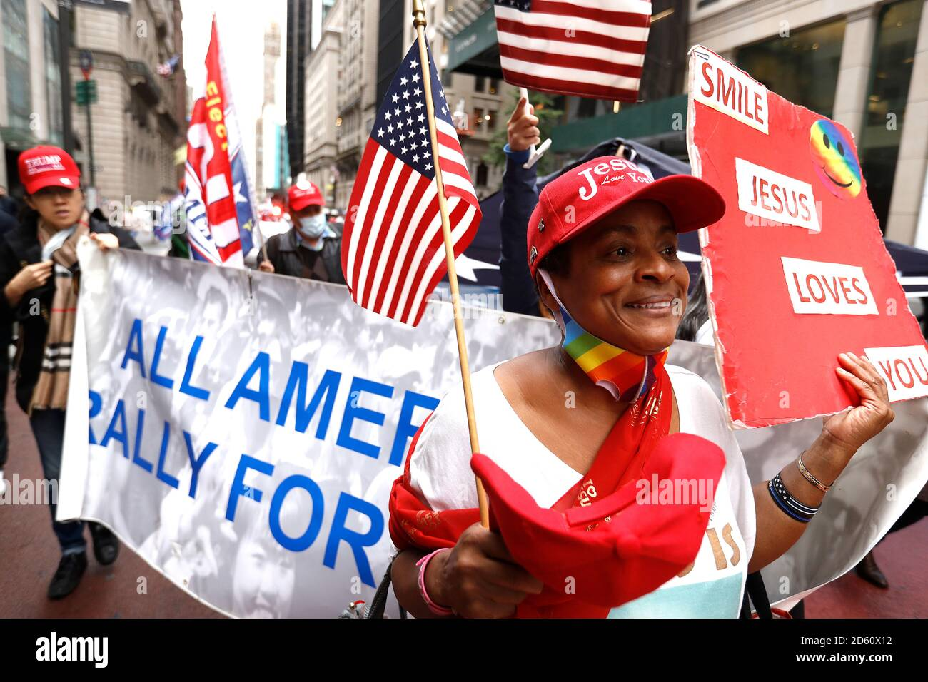 New York, United States. 13th Oct, 2020. Trump supporters march on Fifth Avenue while holding a banner to Times Square as contentious political and judicial topics are being debated in Washington DC. Issues concerning the health of the President and optimism of his re-election resounded among the rally participants. Credit: SOPA Images Limited/Alamy Live News Stock Photo