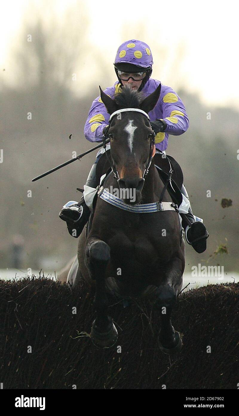 Orana Conti ridden by Jockey Thomas Phelan jumps the last fence to win the Leicester Annual Members Novices' Handicap Steeple Chase at Leicester Racecourse Stock Photo