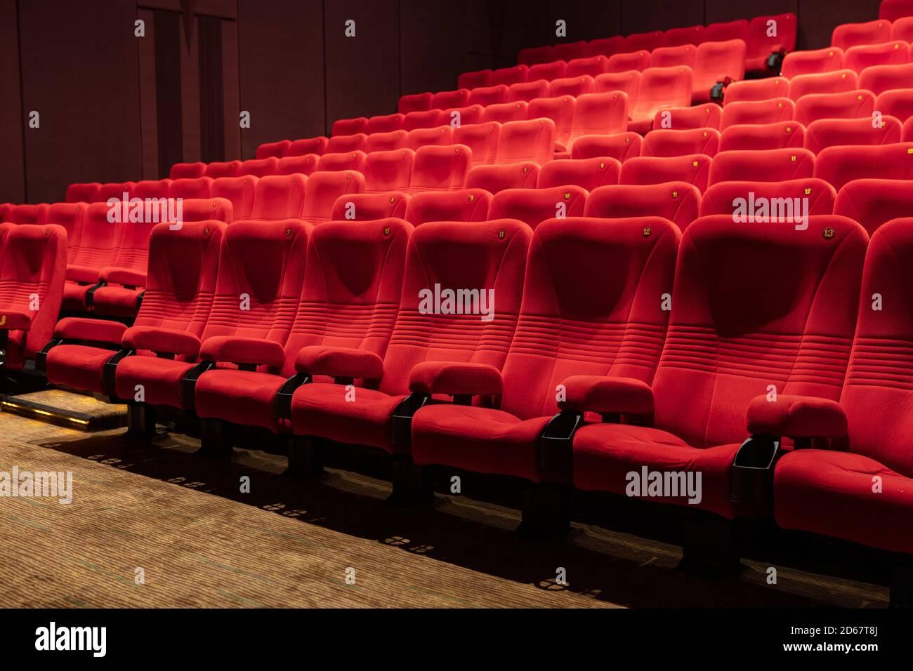 Empty Red Cinema Seat on Movie Theatre Stock Photo