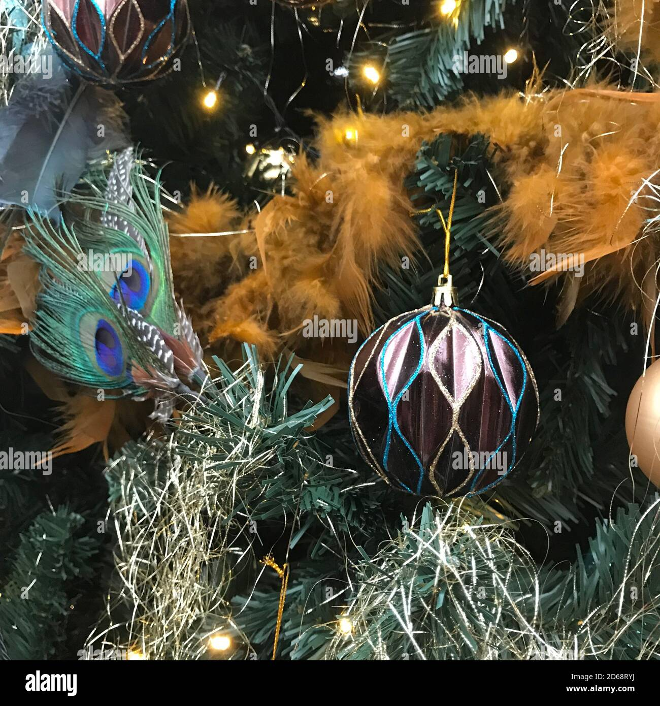 Christmas Decoration In Purple And Gold With Peacock Feather Lights And Balls In A Christmas Tree Stock Photo Alamy