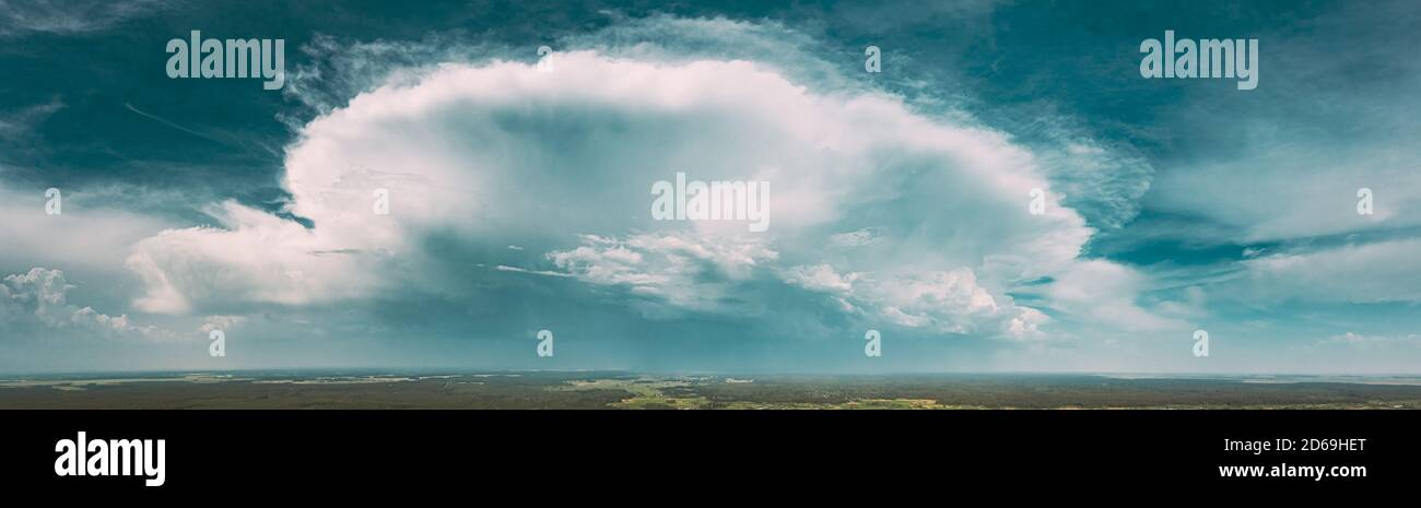 Aerial View. Amazing Natural Dramatic Sky With Rain Clouds Above Countryside Forest Landscape In Summer Cloudy Day. Scenic Sky With Fluffy Clouds On Stock Photo