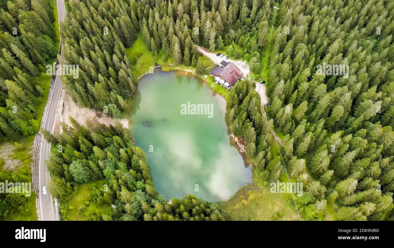 Beautiful Chalet in the middle of the forest, along a lake border. Stock Photo