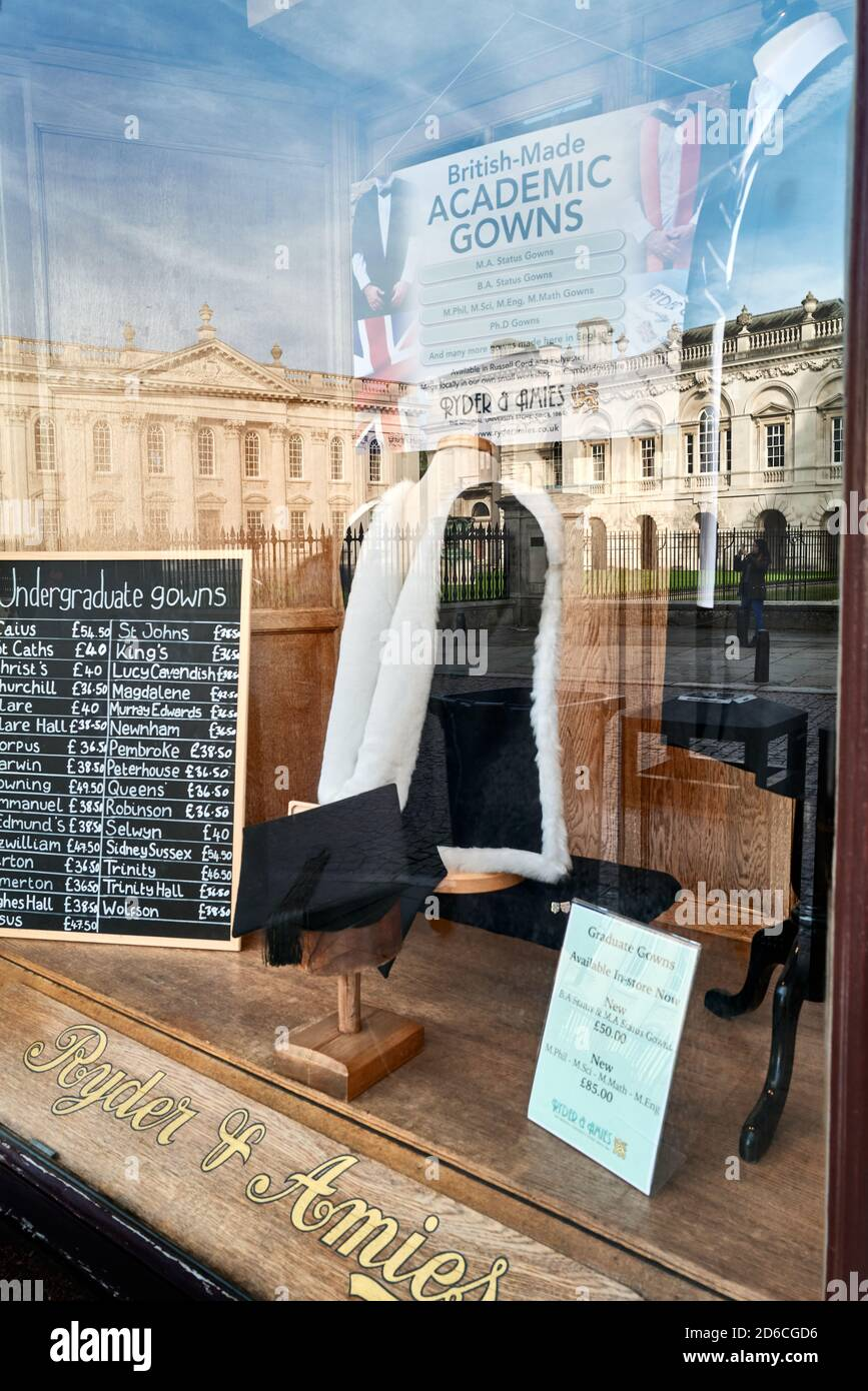 Shop window of Ryder & Amies (seller of academic gowns) with reflection of Senate House, university of Cambridge, England. Stock Photo