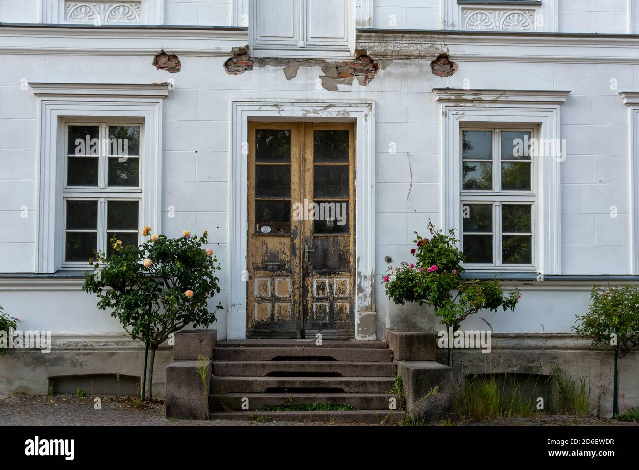 Germany, Mecklenburg-Western Pomerania, Putbus, dilapidated Kavaliershaus at Rondellplatz Circus Stock Photo