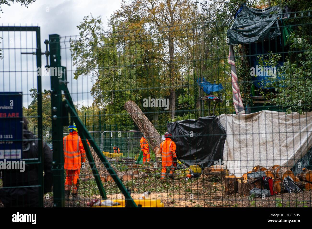 Denham, UK. 16th October 2020. HS2 were at work again today in the normally tranquil Denham Country Park, destroying mature trees. This is in readiness for a new temporary bridge that is being built to take their lorries and equipment across the River Colne. The trees being felled today by HS2 were right next to the Denham Ford Protection Camp where HS2 Rebellion anti HS2 environmental campaigners are living in the woods. A mature tree felled by HS2 this morning crashed through HS2 high security fences onto a footpath near to where a protester was filming Stock Photo