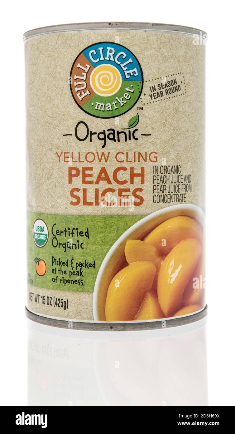 Winneconne, WI - 16 October 2020:  A package of Full Circle market yellow cling peach slices on an isolated background. Stock Photo