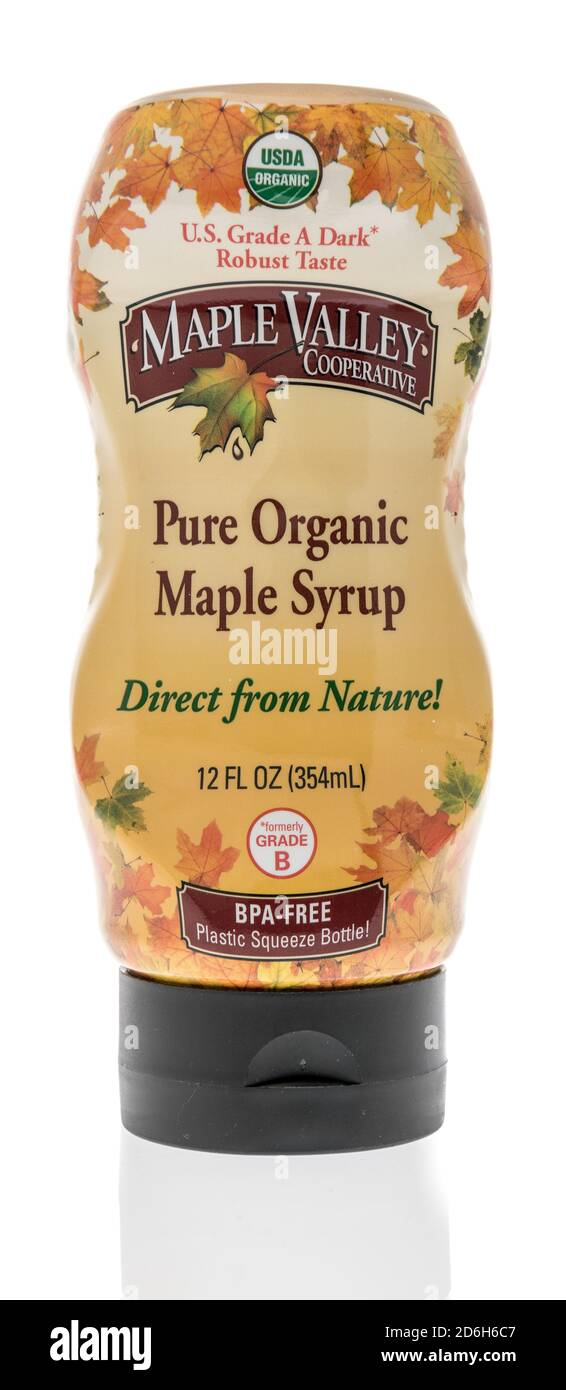 Winneconne, WI - 16 October 2020:  A package of Maple Valley coopertative pure organic maple syrup on an isolated background. Stock Photo