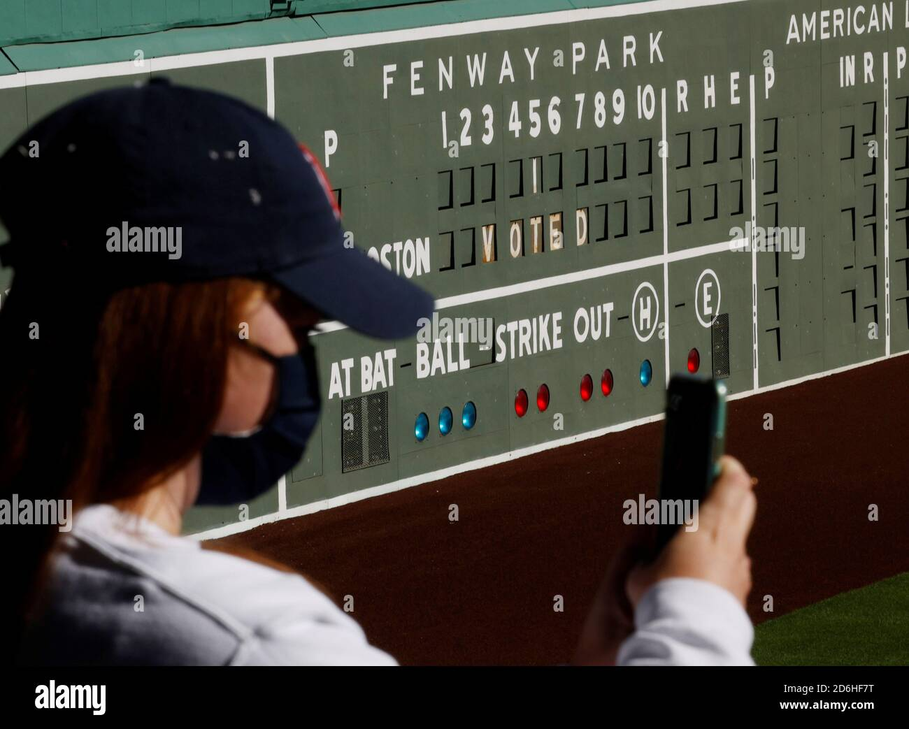 A voter takes a selfie after casting her ballot at Fenway Park on the first day of early voting in Boston, Massachusetts, U.S., October 17, 2020.   REUTERS/Brian Snyder Stock Photo