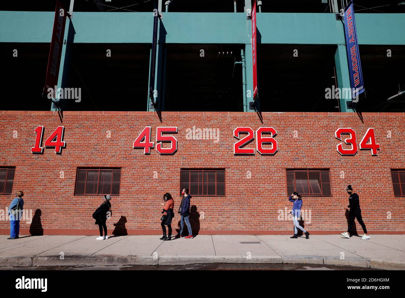 Voters wait to cast their ballots in a line wrapping around Fenway Park on the first day of early voting in Boston, Massachusetts, U.S., October 17, 2020.   REUTERS/Brian Snyder Stock Photo