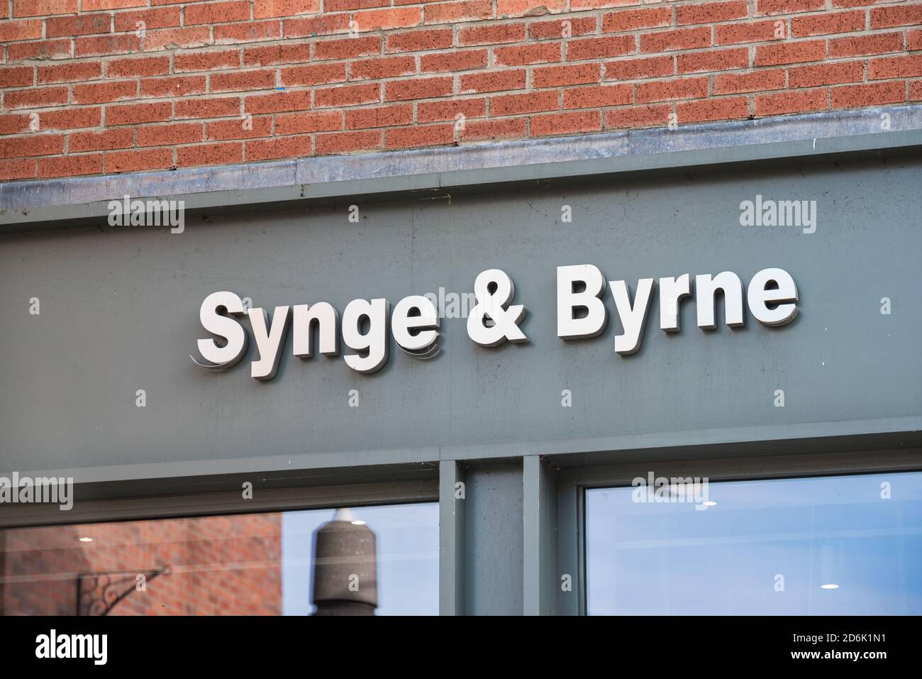 Derry, Northern Ireland- Sept 27, 2020: The sign for Synge & Bryrne in Derry. Stock Photo
