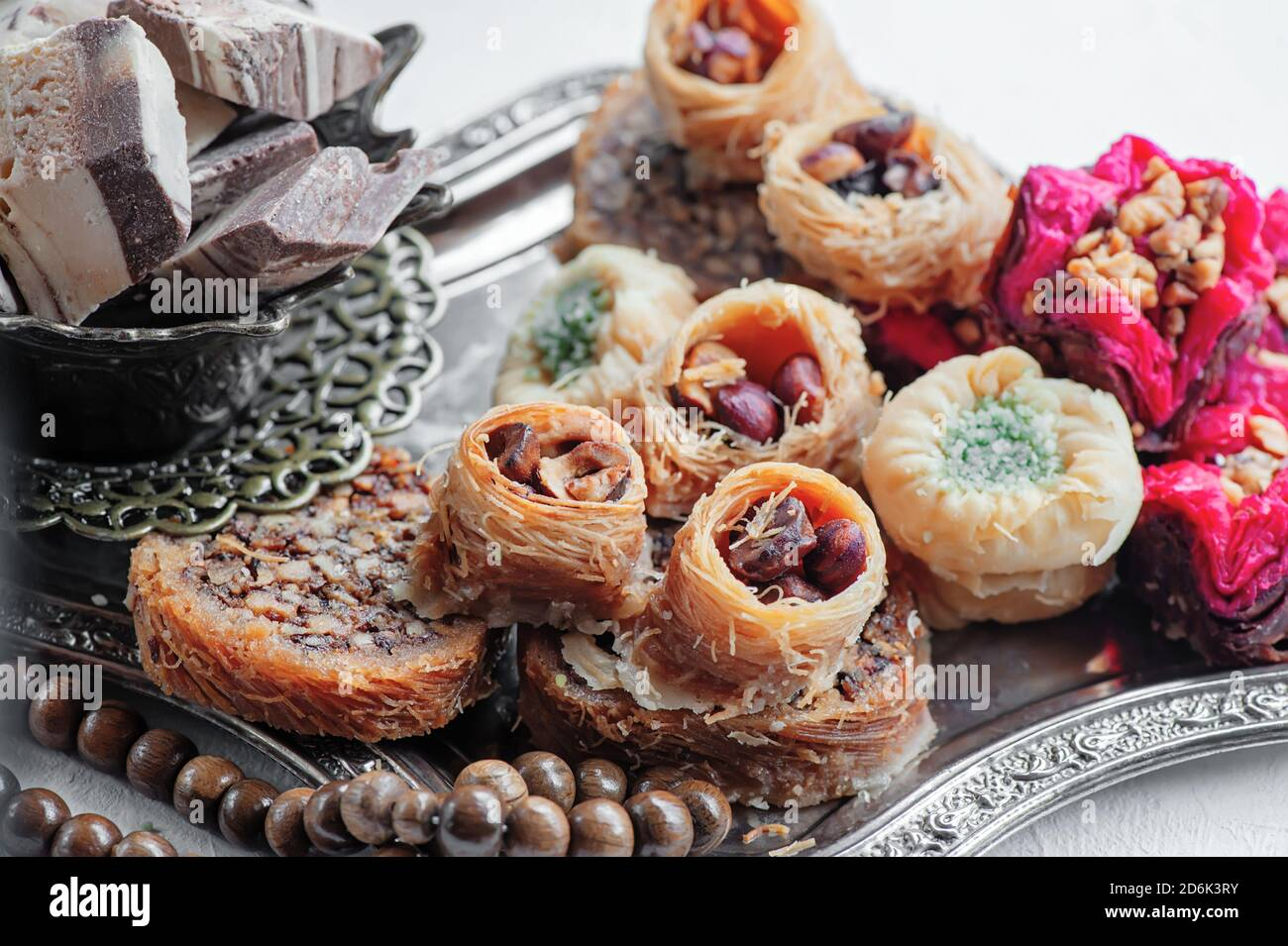 Arabic, Lebanese and Turkish sweets kataifi and kanafeh, a Traditional Eastern dessert made of thin dough with syrup , nuts and seeds. Close up Stock Photo