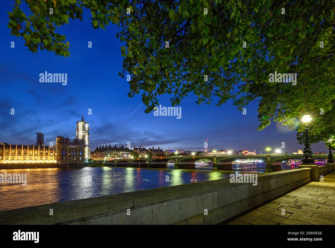 Houses of Parliament in Westminster, London, UK. View across the Thames with Westminster Bridge. Vehicle light trails and long exposure motion blur. Stock Photo