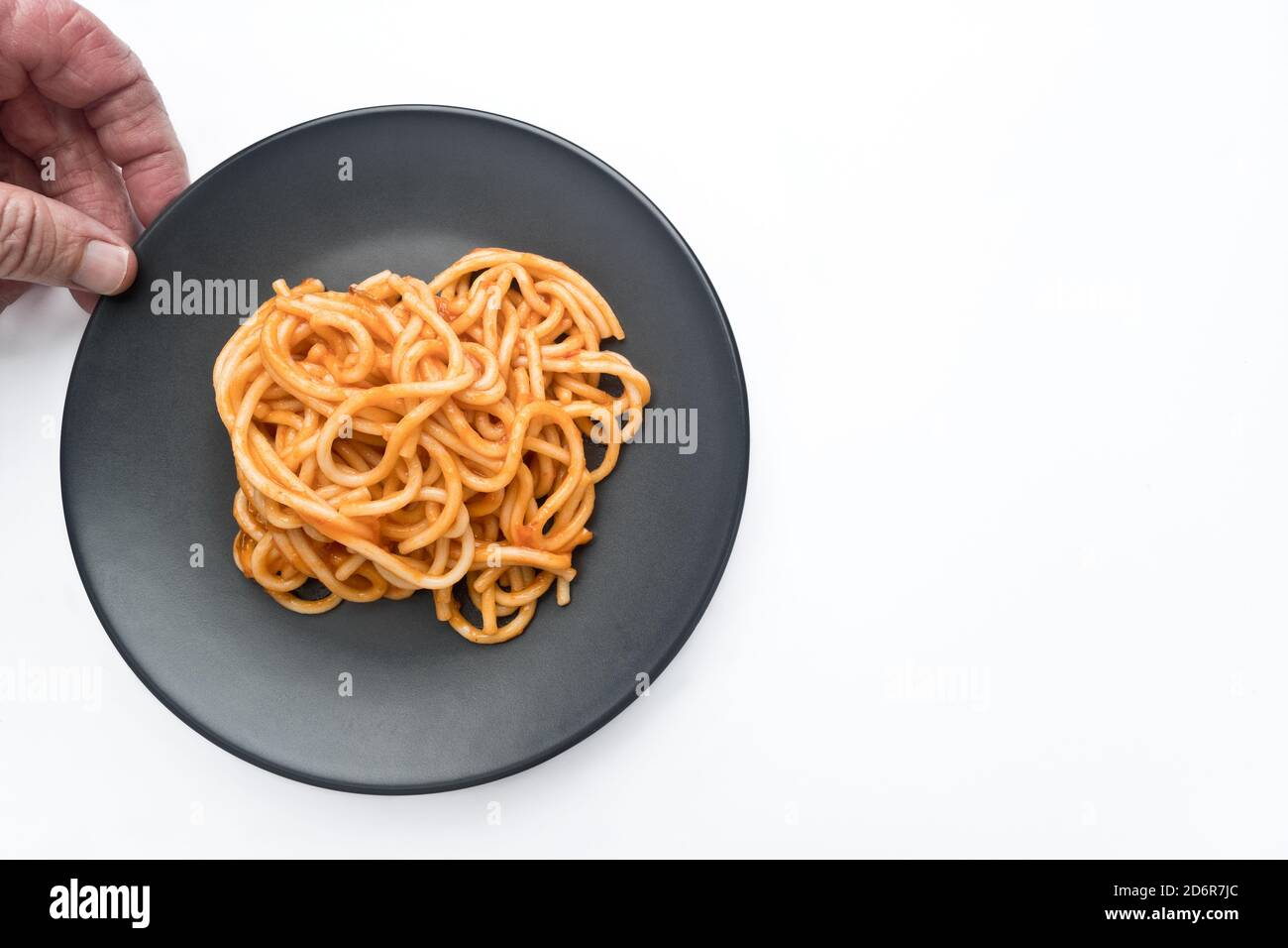 Spaghetti Bolognese are one of the most typical and well-known ways of making. It consists of a paste, seasoned with a sauce whose ingredients are tom Stock Photo