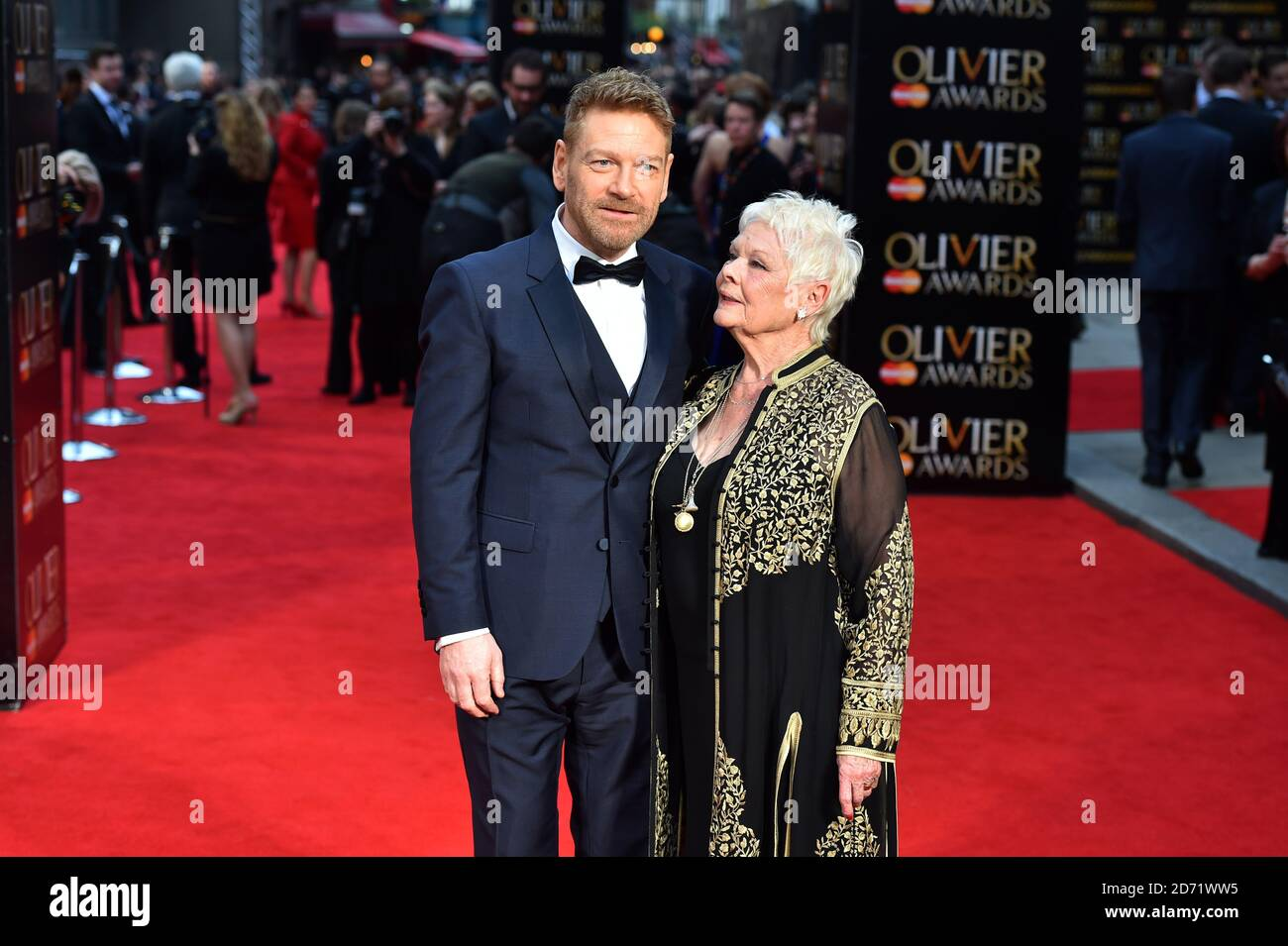 Dame Judi Dench and Kenneth Branagh attending the Olivier Award, at the Royal Opera House in London. Stock Photo