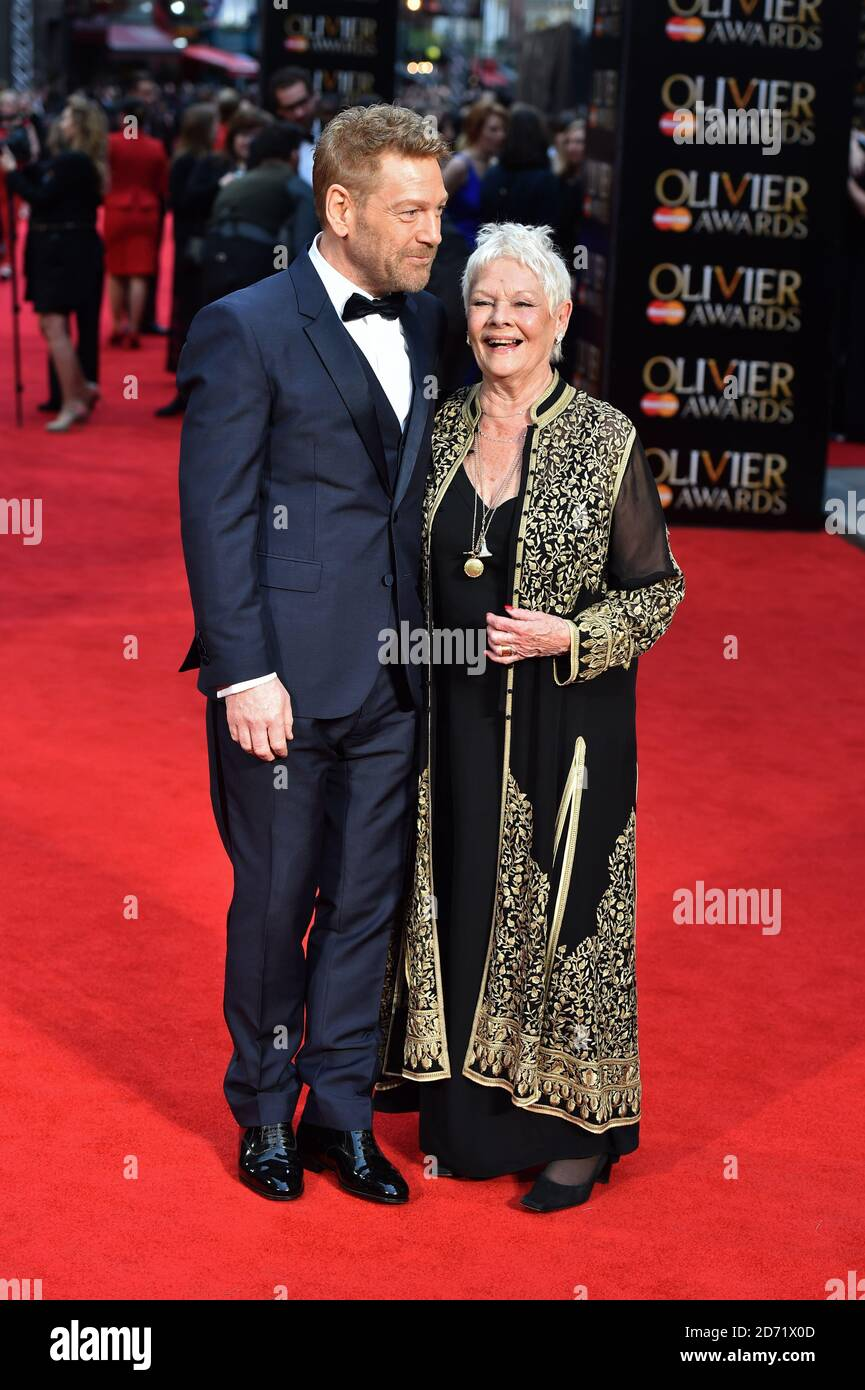 Kenneth Branagh and Dame Judi Dench attending the Olivier Awards, at the Royal Opera House in London. Stock Photo