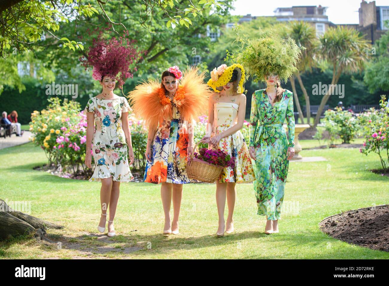 Models wear creations by couturier Catherine Walker & co. and florist Hayford and Rhodes, in Chelsea, west London. The designs were put together to celebrate the Chelsea Flower Show and Chelsea in Bloom. Picture date: Wednesday May 23rd, 2018. Photo credit should read: Matt Crossick/ EMPICS Entertainment. Stock Photo