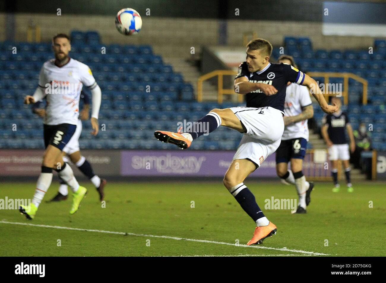 London, UK. 20th Oct, 2020. Shaun Hutchinson of Millwall takes a shot at goal. EFL Skybet Championship match, Millwall v Luton Town at the Den in London on Tuesday 20th October 2020. this image may only be used for Editorial purposes. Editorial use only, license required for commercial use. No use in betting, games or a single club/league/player publications. pic by Steffan Bowen/Andrew Orchard sports photography/Alamy Live news Credit: Andrew Orchard sports photography/Alamy Live News Stock Photo