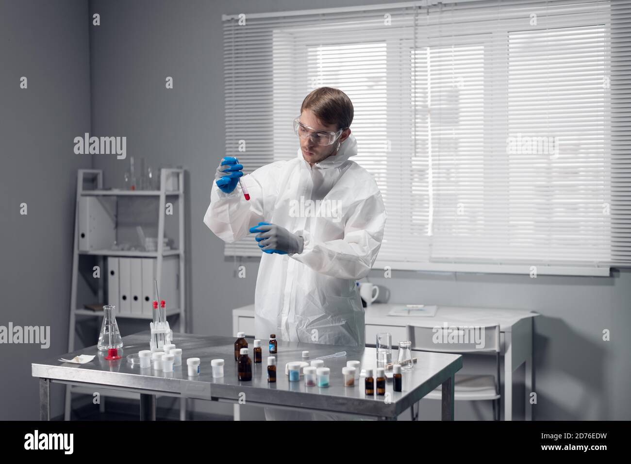 Male chemist carrying out a scientific research in his laboratory. Stock Photo