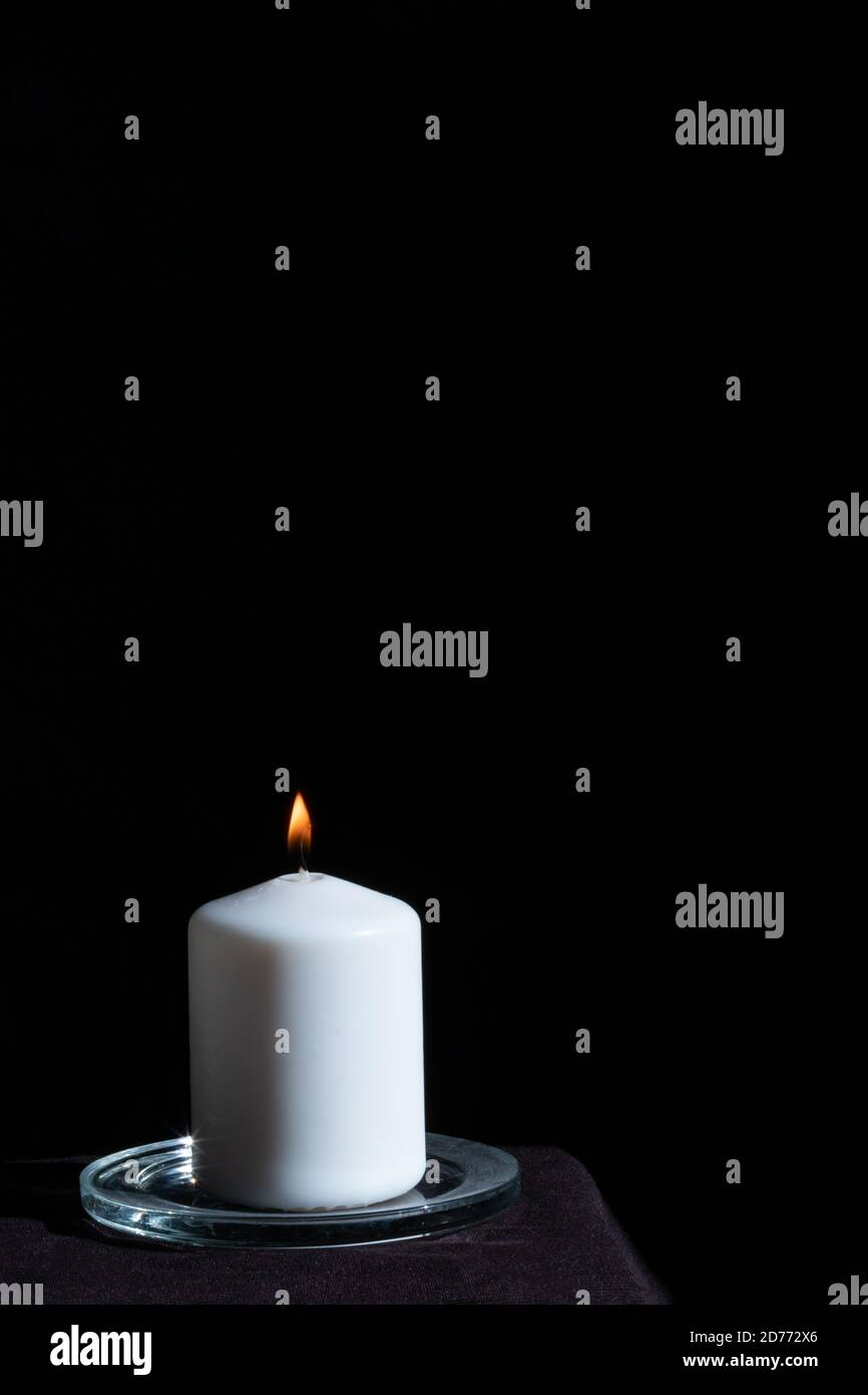 candle burning  in the dark, halloween or prediction concept Stock Photo