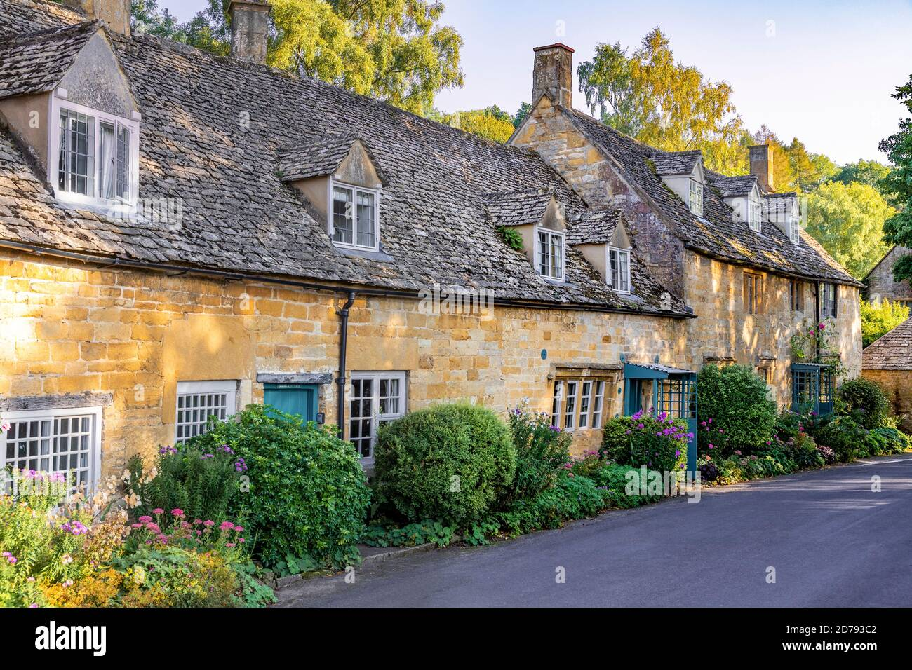 Evening light on traditional stone cottages in the Cotswold village of Snowshill, Gloucestershire UK Stock Photo