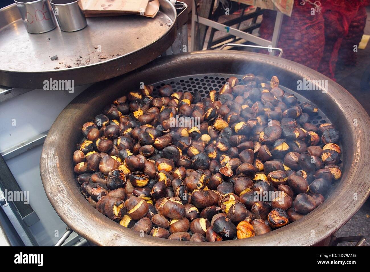 Roasting chestnuts in the open air Stock Photo