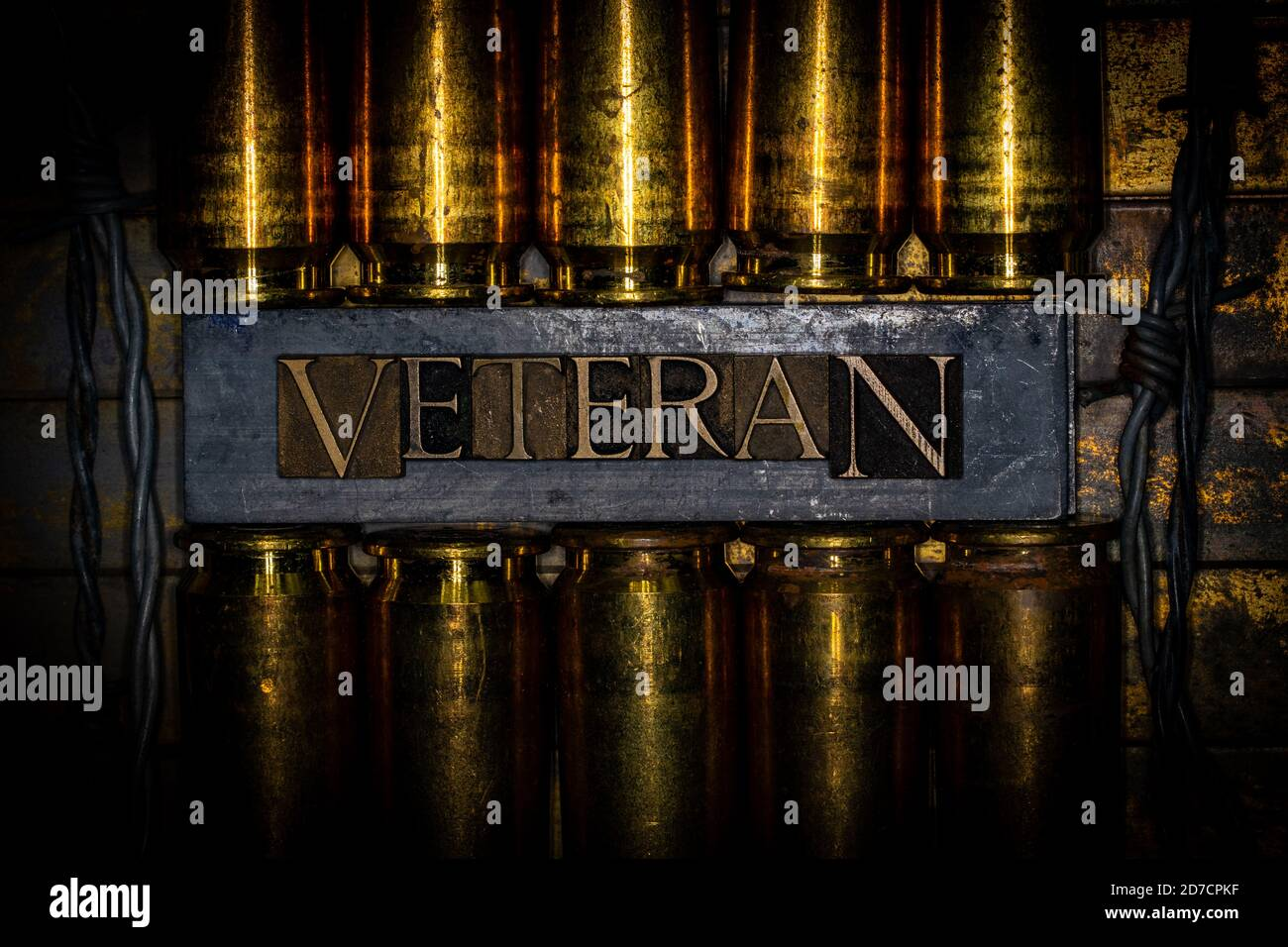 Veteran text message transposed on lead bars over copper 50 caliber gun casings on vintage textured grunge copper and gold background Stock Photo