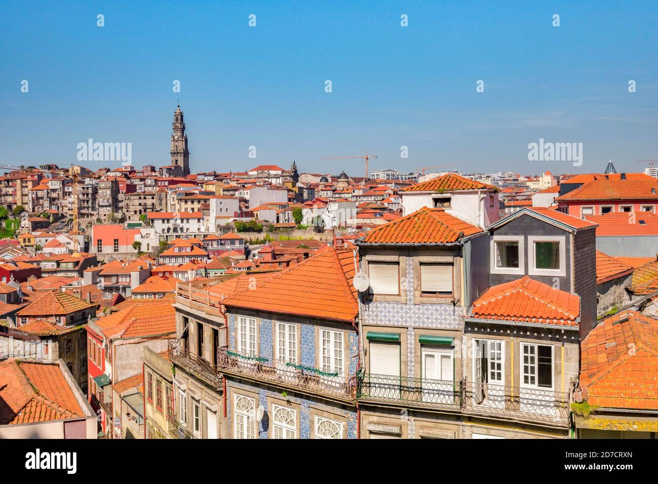View across the tiled roofs of Porto, Portugal, on a fine spring day. The skyline is dominated by the tower of the Igreja dos Clérigos, the Church of Stock Photo