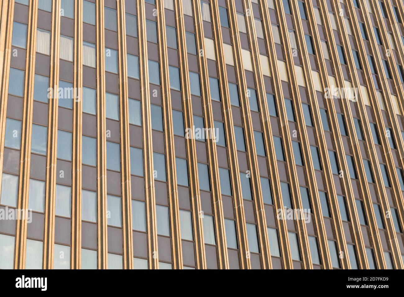 A repeating pattern of windows on a skyscraper. Stock Photo