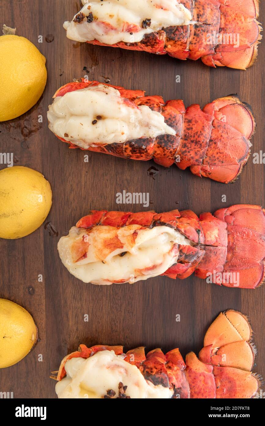 Lobster tails that are saddleback style cooked with lemons Stock Photo