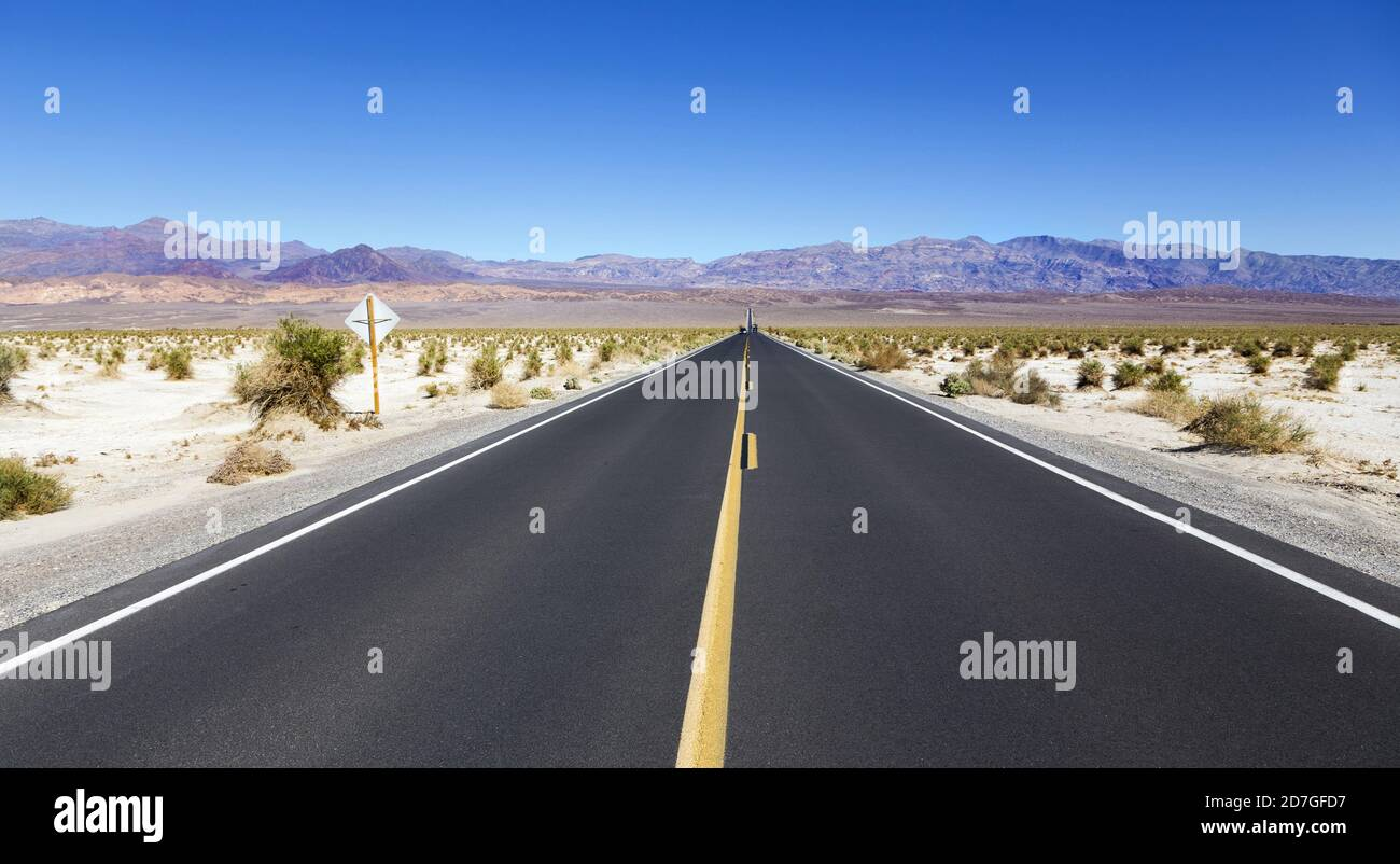 Driving Iconic State Highway 190 from Panamint Springs to Distant Mountains and Towne Pass in Death Valley National Park, California USA Stock Photo